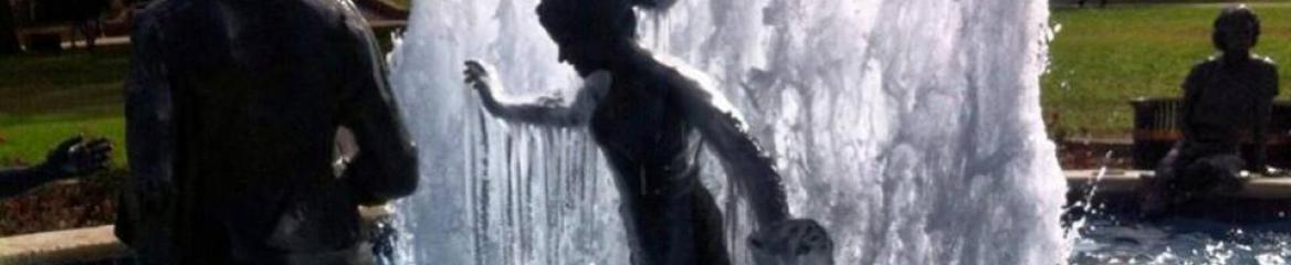 Picture of an iced over statue in a fountain